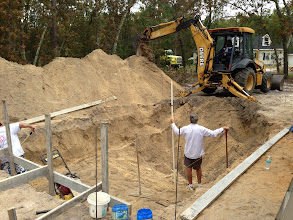 Photo: November 14, 2012 Digging the pool, measuring the depth. Photo by Fiesta Pools