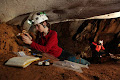 Sediment sampling in a notch in Racer Cave | photo © Robbie Shone