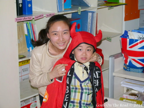 Teaching assistant with student. From 7 Ways To Save $10,000 Teaching English In China