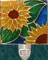 two sunflowers on blue