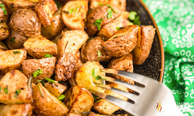 rosemary potatoes on a fork