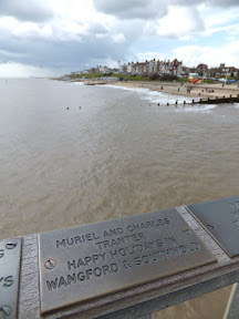 One of the many brass remembrance plates on the rails of Southwold Pier