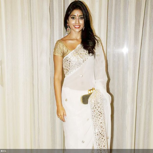 Shriya Saran opts for ivory sari at 4th NBC Awards, held in Mumbai, on May 1, 2013. (Pic: Viral Bhayani)