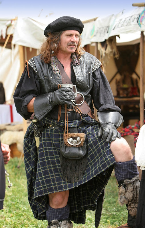 A belted plaid (rather than a kilt) as worn by a reenactor of Scottish history.
