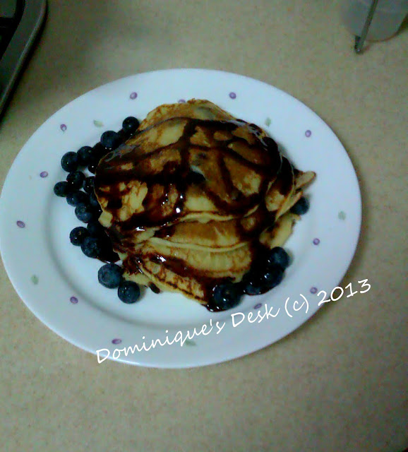 Blueberry pancakes with chocolate sauce