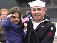 030303-N-8273J-008 Naval Air Station North Island, Calif. (Mar. 3, 2003) -- Amidst tears and last kisses, MachinistÕs Mate Fireman Luis Rangel a crewmember assigned to USS Nimitz (CVN 68), says goodbye to his daughter before boarding the aircraft carrier.  Nimitz, her battle group, Cruiser Destroyer Group Five, and her embarked Carrier Air Wing Eleven (CVW-11) are deploying in support of Operation Enduring Freedom.  U.S. Navy photo by Photographer's Mate 2nd Class Tiffini M. Jones.  (RELEASED)