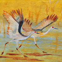 pair Cranes golden birds