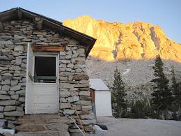 Backdoor of Vogelsang kitchen... sun going down on Fletcher peak in the background.