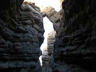 Natural Arch perched high above our heads in The Slot