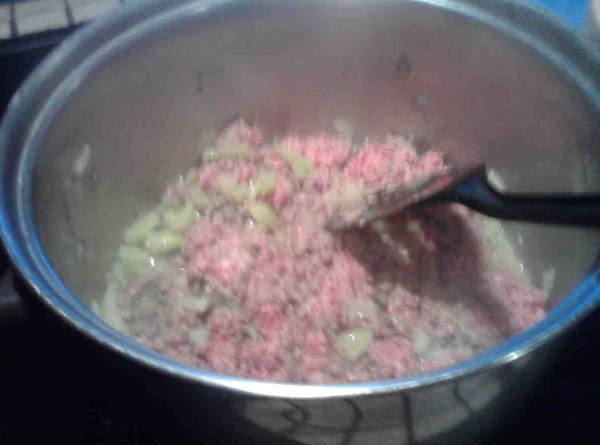 Set crockpot to high. In a pot on stovetop brown ground beef with onions, peppers...