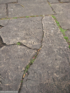 2012. This is cracked, but that's because it's a grave slab from the old church or its churchyard