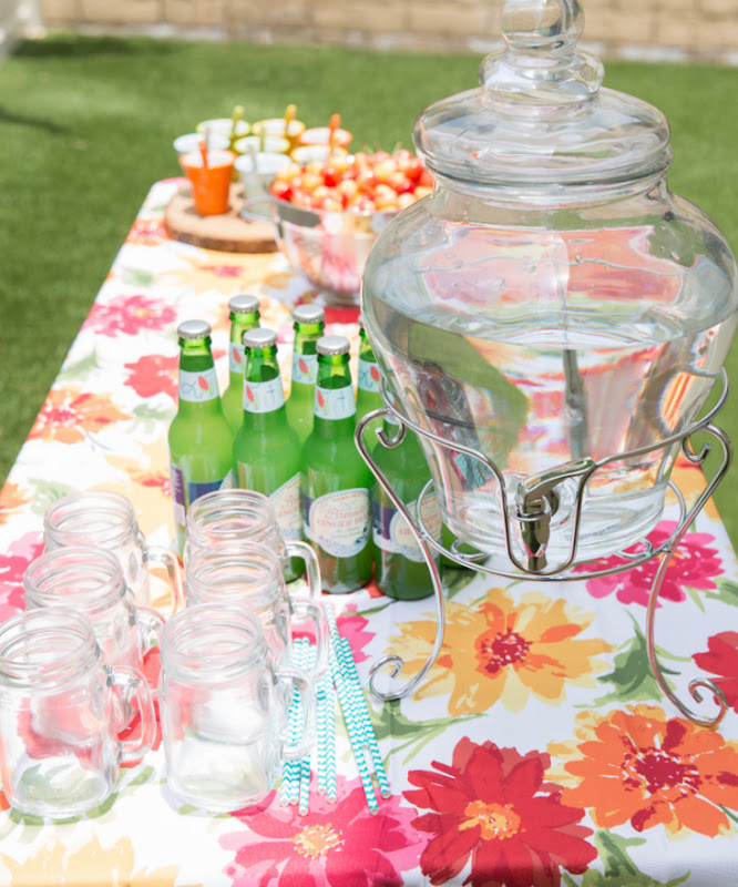 photo of a table topped with drinks and glassware