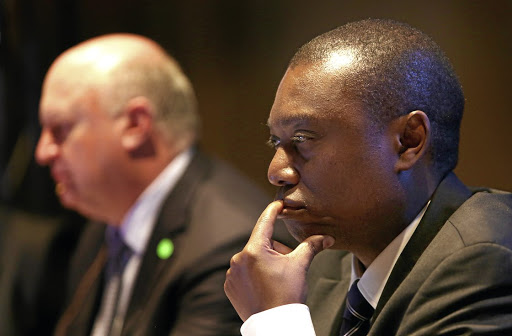 Standard Bank CEO Ben Kruger and fellow CEO Sim Tshabalala at a Standard Bank annual general meeting in Johannesburg. Picture: JAMES OATWAY