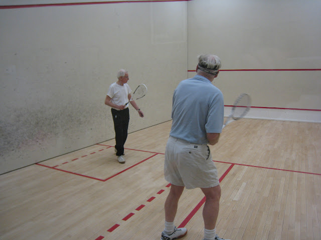 Anthony Moore, Consolation Finalist, serving to Will Jansen, Consolation Winner, in the 75+ flight.