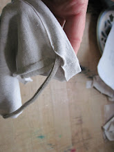Photo: Feed a drawstring through the pocket.  I used an old sport shoelace I had lying around.