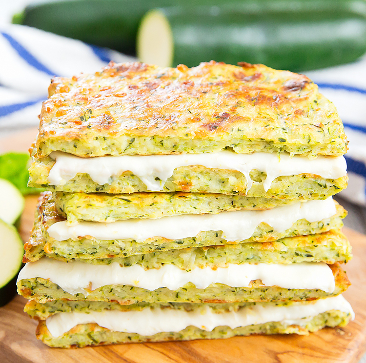 a close-up of a stack of zucchini crusted grilled cheese sandwiches