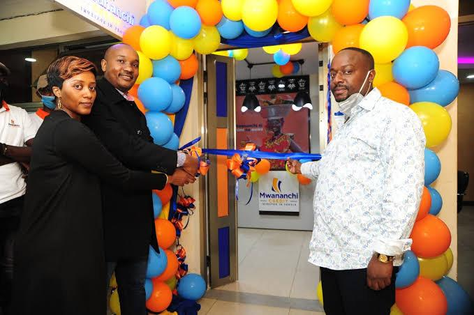 Mwananchi Credit CEO Dennis in black suit opens the company's Thika branch/HANDOUT