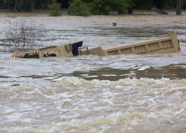 A Louisiana Army National Guard dump truck that drove off the road is submerged in flood waters near Walker, Louisiana, after heavy rains inundated the region on 14 August 2016. The weather of the summer of 2016 was relentless and hellish, crowded with the type of record-smashing extremes that scientists have long warned about. Summer featured floods that killed hundreds of people and caused more than $50 billion in losses around the globe, from Louisiana and West Virginia to China, India, Europe, and the Sudan. Meanwhile, droughts parched croplands and wildfires burned from California to Canada to China and India. Photo: Max Becherer / AP Photo