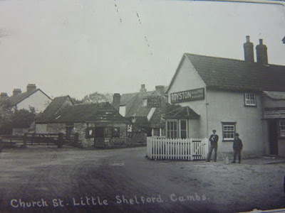 "Blacksmith and The Prince Regent Pub, from Church Street, Little Shelford. ""The festivities connected with the annual village feast were celebrated at this public house. There was dancing in the evening and a fair in the daytime and the stalls and booths were placed on each side of Church Street."" From A Record of Shelford Parva by Fanny Wale P29."