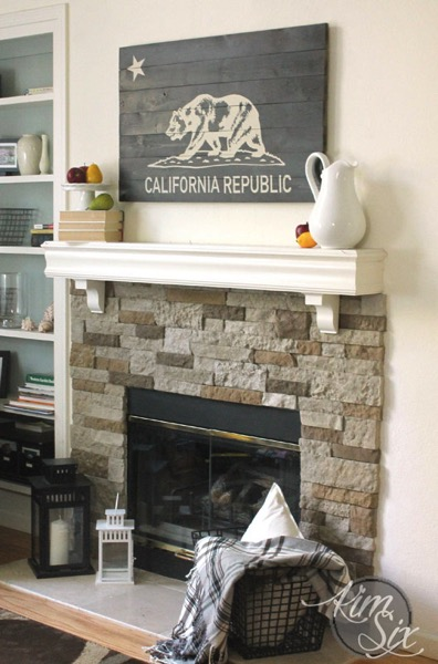Rustic Stenciled wooden sign over fireplace