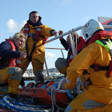 Preparing to transfer the casualty from the tug on a stretcher - Training exercise, 19 February 2012