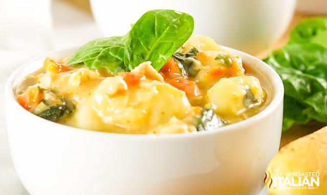 gnocchi chicken soup in a white bowl