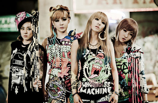 "2NE1 reveals photos from ""Ugly"" MV set"