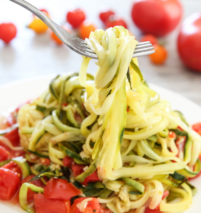 close-up photo of forkful of zucchini noodles