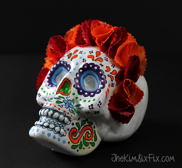 Day of the dead sugar skull made from a Dollar store plastic skull, craft paint and stiffened fabric flowers