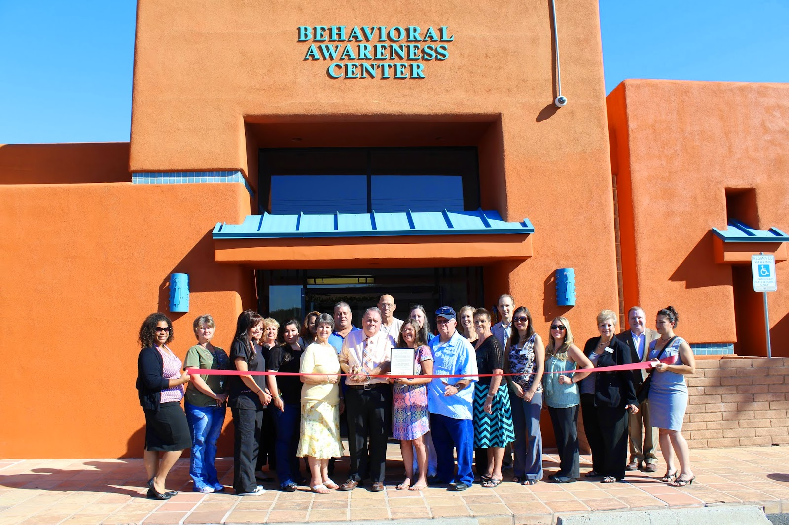 Grand opening of Behavioral Awareness Center's new building.  Ribbon Cutting ceremony occurred on September 23rd.  Pictured are Brackie Sekavec, Owner and CEO, with Chamber members.