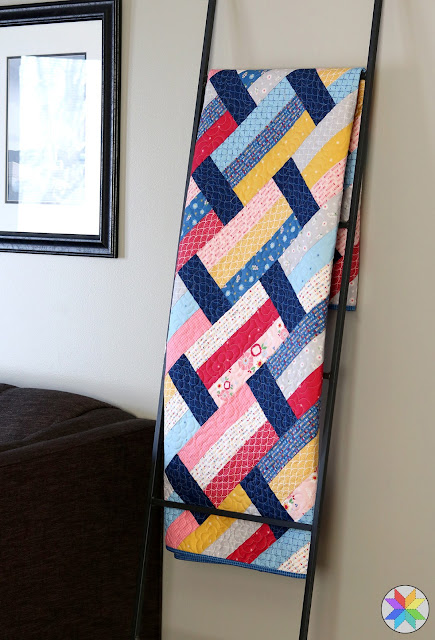 Love this modern quilt ladder! Quilt pattern is Fast Track by A Bright Corner - great for precuts and fat quarters
