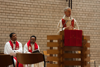 Photo: Pastor van Hattem delivers a welcome message to the new congregation.