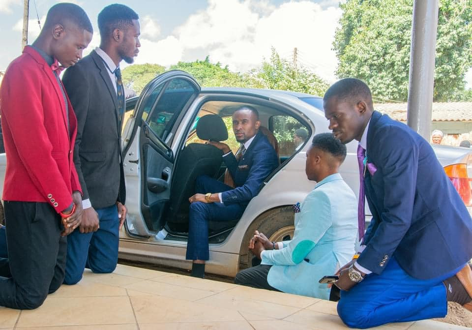A Church Where members kneel down to welcome their pastor in Zambia