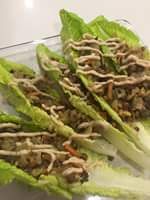 """""""Majadra-ish"""" lettuce cups. Brown rice and lentil mix with onions, carrots and parsley, all cooked together with spices, topped with hummus and some lemon!"""