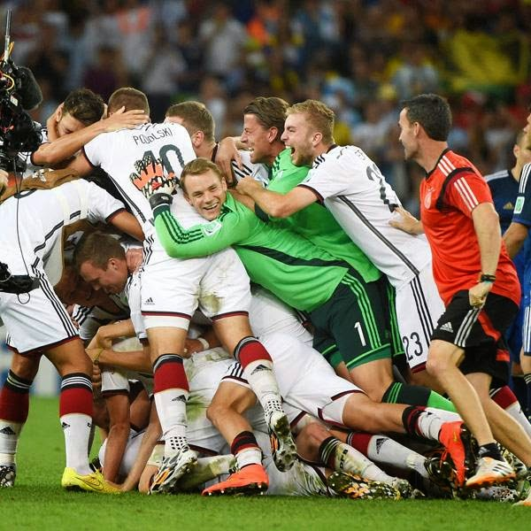 Germany's players celebrate after winning the final football match between Germany and Argentina for the FIFA World Cup at The Maracana Stadium in Rio de Janeiro on July 13, 2014.