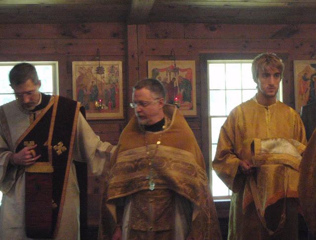 Fr. Michael guides Fr. John.
