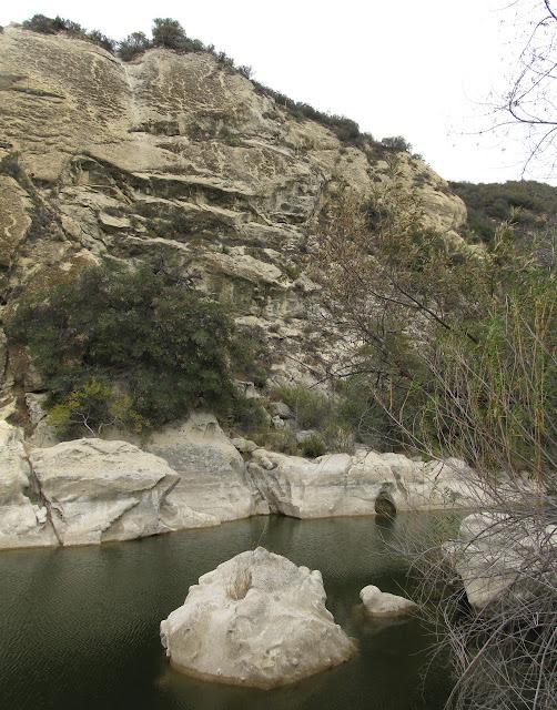pool below steep rock
