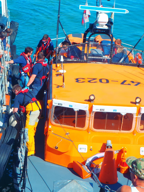 The ALB crew sort out the fenders as the lifeboat comes in to Bournemouth Pier to bring a person ashore following a medivac from one of the passenger vessels in Poole Bay. 31 August 2013 Photo: RNLI Lifeguards