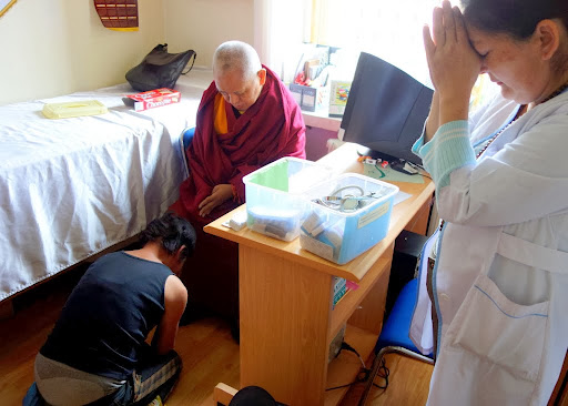Health clinic patient made prostrations to Rinpoche upon learning of his support of the Lamp of the Path, which she says is keeping her alive, Ulaanbaatar, Mongolia, September 3, 2013. Photo by Ven. Roger Kunsang.