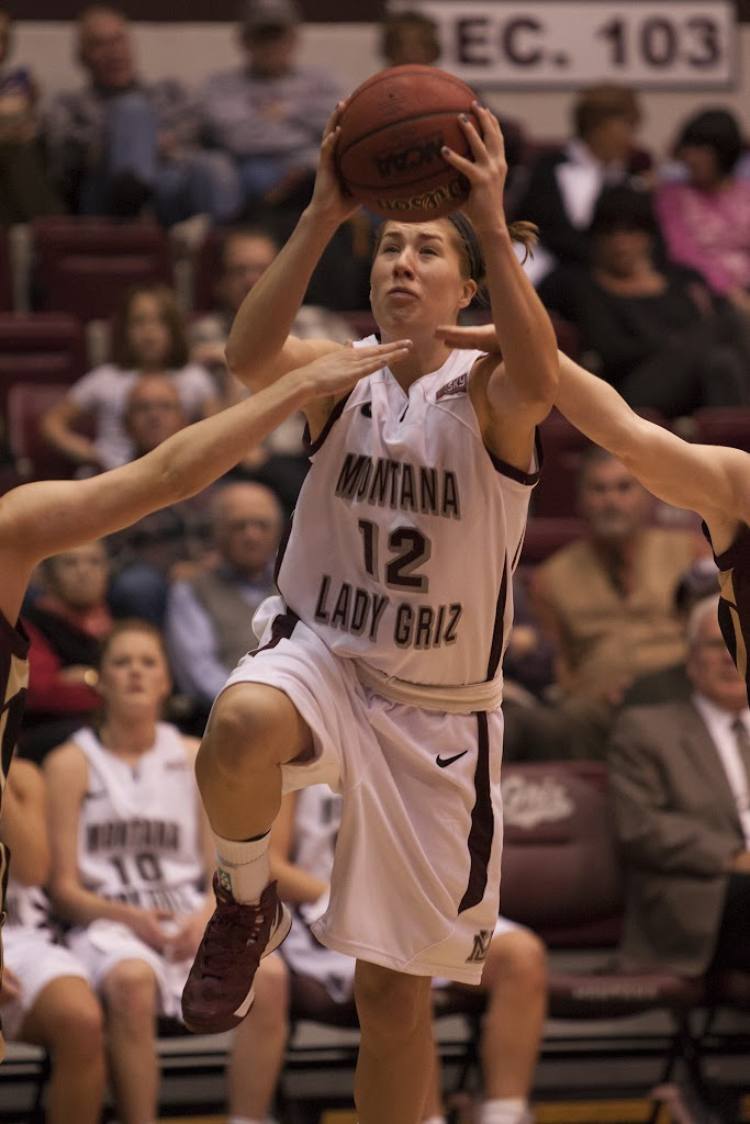 Sophomore guard Kellie Cole fights through the hands of two MSU-Northern defenders en route to two of her ten points in Tuesday's 75-45 victory.  Dahlberg Arena in Missoula, Mont., November 13th, 2012.