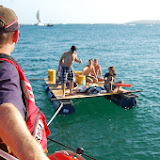 The ALB crew tow a home-made raft and its occupants to Durley Chine. 31 August 2013 Photo: RNLI Poole/Dave Riley