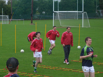 John Gorman, Stephen Abbott & Sean Pender training watched on by selector Kevin Guing
