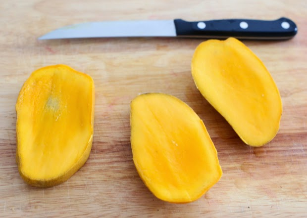 step-by-step photo showing how to peel and cut the mangos