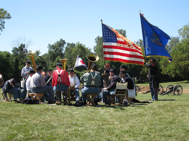 Michigan 5th's flags wave as band plays before the Battle of Jonesborough