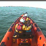 Poole inshore lifeboat crew with one kayaker and kayak onboard heading to pick up a second kayaker - 18 April 2014 Photo: RNLI Poole