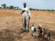 A happy goat owner in South Sudan