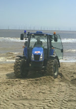Photo: The tractor with 'blues & twos' preparing to take the Zodiac out of the way for the lifeboat to land.