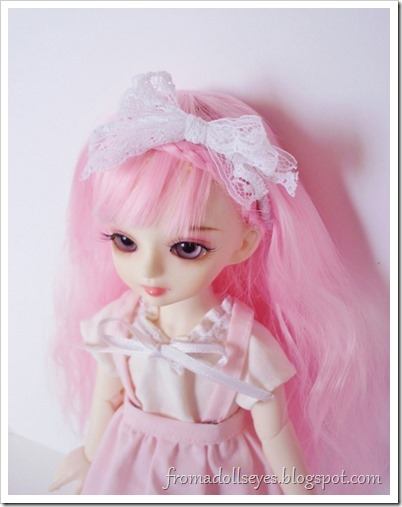A cute yosd sized ball jointed doll with pink hair, she was purchased on sale.  Her face up was also included for free as part of the event.