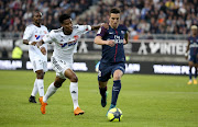 Giovani Lo Celso of PSG, Bongani Zungu of Amiens (left) during the Ligue 1 match between Amiens SC and Paris Saint Germain (PSG) at Stade de la Licorne on May 4, 2018 in Amiens, France.