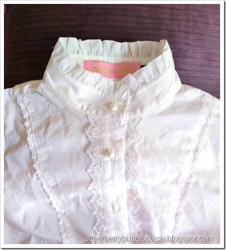 The high collar of the blouse after removing the ruffles.  It looks great like this and could easily be worn for vintage and antique clothing styles like steam punk as well as lolita fashion.